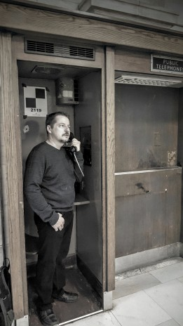Paul Hammons posing at the NY Library phone booth